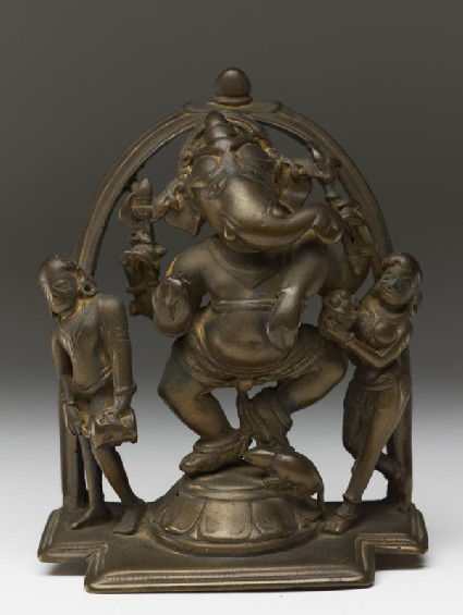 Dancing figure of Ganesha with attendants