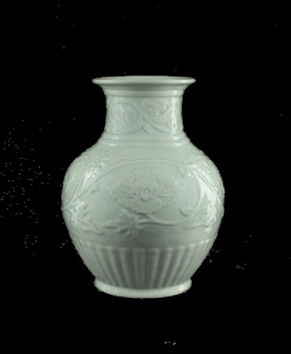 Vase with relief decoration of scrolling peonies