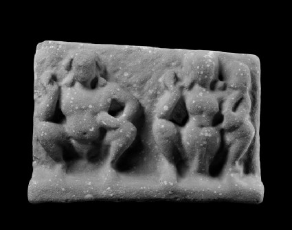Relief plaque with squatting male and female figures, probably deities