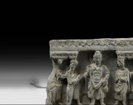 Portion of a frieze with standing Bodhisattva and two worshippers