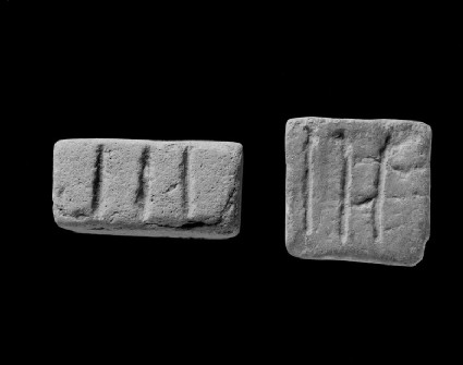 Rectangular object incised with three lines, probably a game counter, weight or sealing