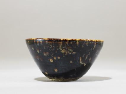 Black ware tea bowl with 'tortoiseshell' glazes