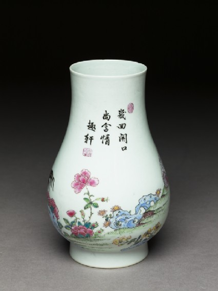 Vase with chickens and flowers