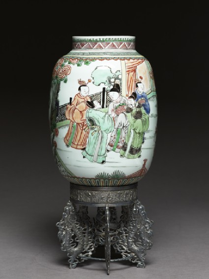 Lantern with figures in a garden