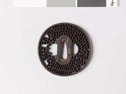 Round tsuba with a large faggot and plum blossoms