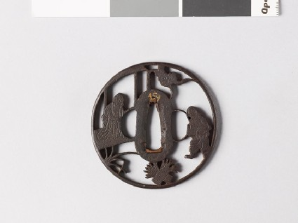 Round tsuba depicting Sōsan, a Paragon of Filial Virtue, and his mother