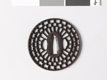 Round tsuba with radiating floral design