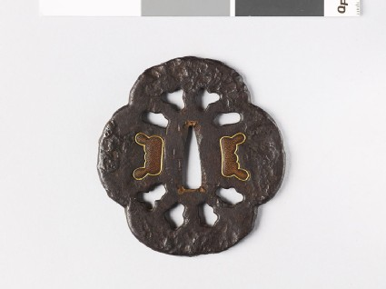 Mokkō-shaped tsuba with decorative plugs