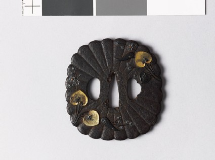 Tsuba with chrysanthemum florets and aoi, or wild ginger