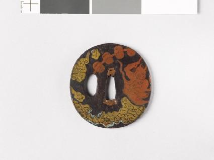 Round tsuba depicting Raiden, the god of thunder