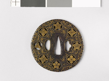 Round tsuba with flowers and water weeds