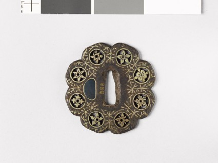 Lobed tsuba with plants including water-weeds
