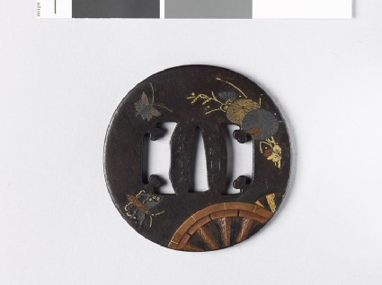 Tsuba with plants, butterflies, and chariot-wheels