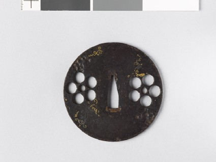 Round tsuba with heraldic mon and scrolls