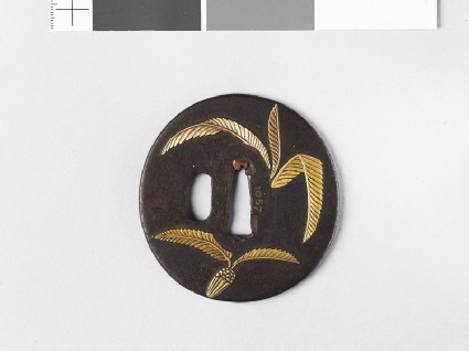 Tsuba with cycad leaves and a radish