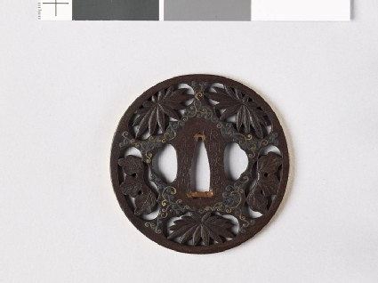 Tsuba with chrysanthemum leaves and scrolling stems