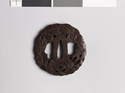 Tsuba with chrysanthemum flowers and leaves