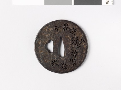 Round tsuba with water plant