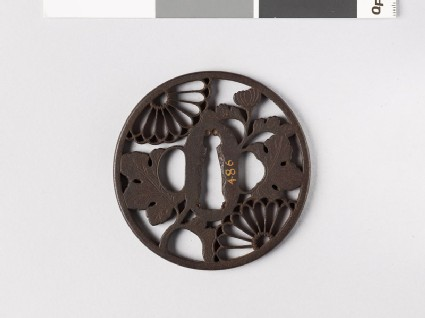 Round tsuba with chrysanthemum flowers and leaves