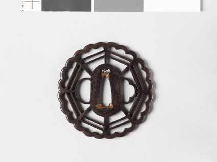 Tsuba with chrysanthemoid border enclosing a cobweb shape