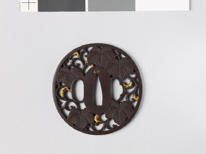 Tsuba with Cissus leaves and karakusa, or scrolling plant pattern