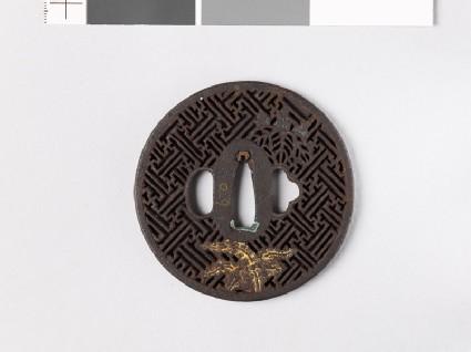 Round tsuba with rinzu, or swastika-fret diaper, and mon made from kiri, or paulownia leaves