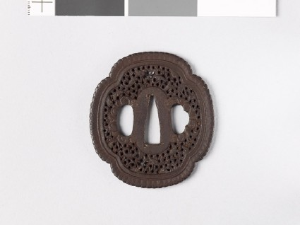 Mokkō-shaped tsuba with scrollwork and fish