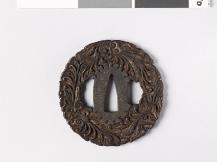 Tsuba with leaves and branching tendrils