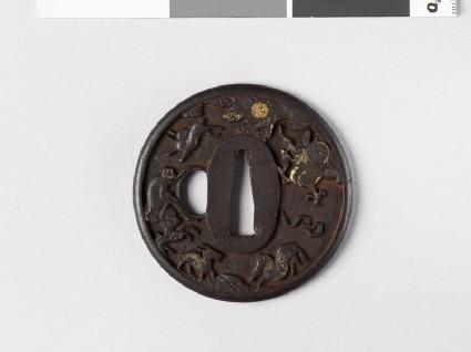 Round tsuba with animals of the Chinese zodiac amid rocks