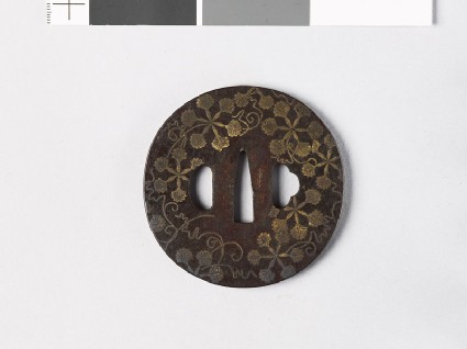 Round tsuba with heraldic leaves