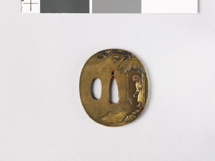 Tsuba depicting a man with a fox trap