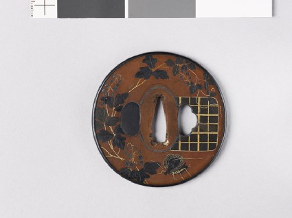 Tsuba with flowering vine and butterfly
