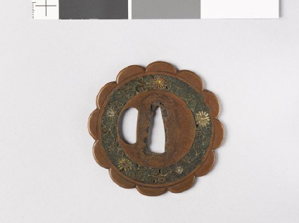 Lobed tsuba with chrysanthemum mon and scrolls