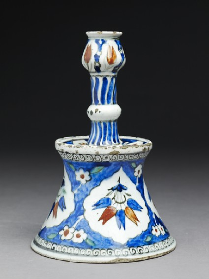 Candlestick with tulip blossoms
