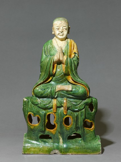 Roof ridge tile in the form of a seated Buddhist figure