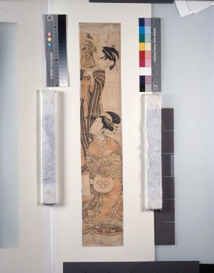 Seated courtesan being shown an ukiyo-e print