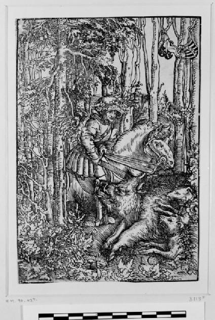 Hunter on horseback hunting a wild boar