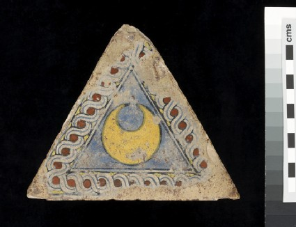 Triangular tile with a crescent