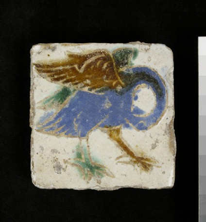 Tile with a pelican