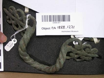 Bronze cauldron handle, twisted like a cord