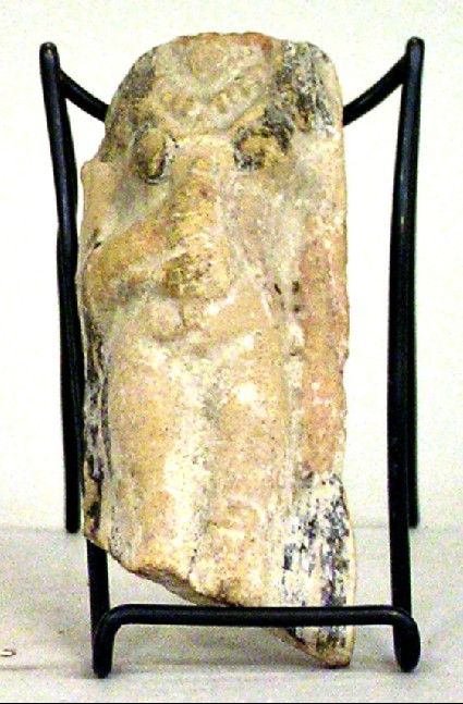 Votive-figurine of female votary with jewellery and bird