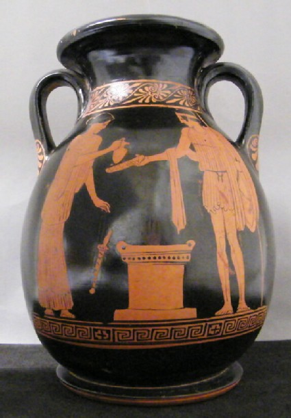 Attic red-figure pottery pelike depicting a religious scene