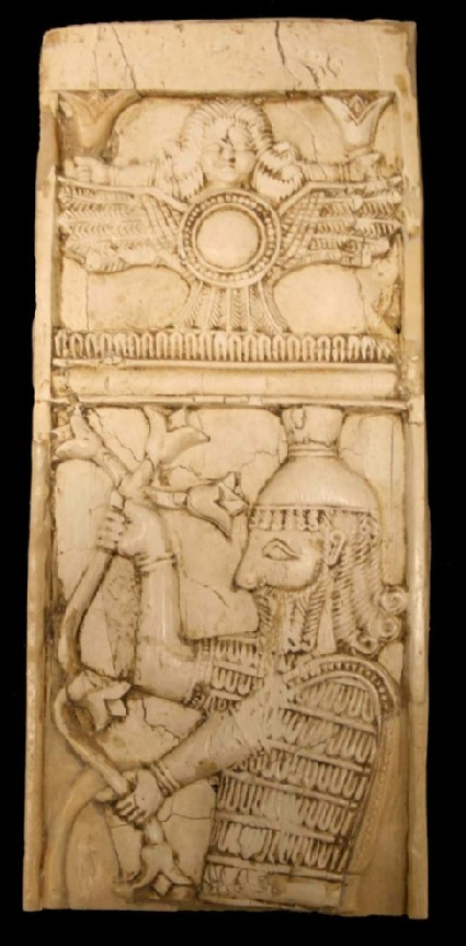 Ivory plaque depicting panel containing the solar disc with wings and tail-feathers, mounted by a female head