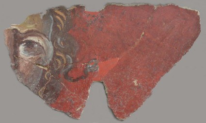 Wall plaster fragment depicting part of a head against a red ground