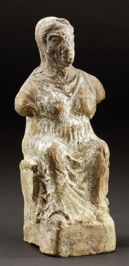 Terracotta figurine of seated old woman