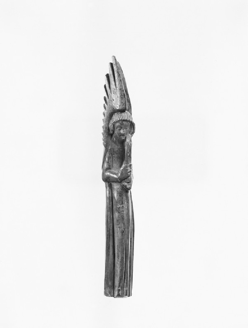 Carving of an angel holding a candelabrum (AN1892.2623)