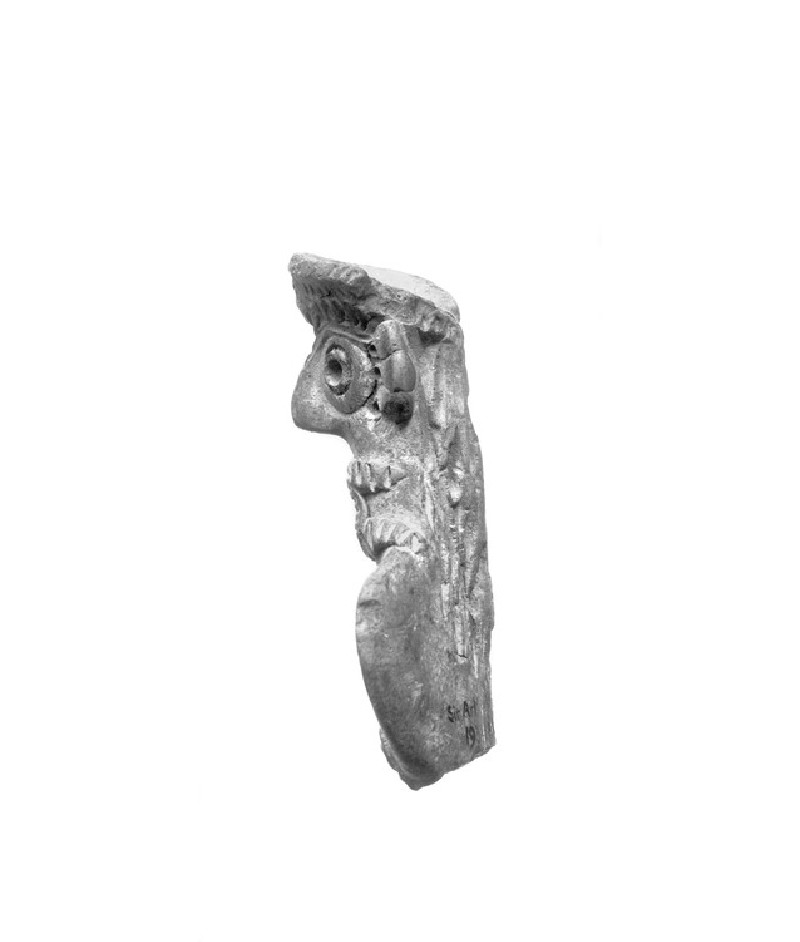 Female figurine with crown and long hair (AN1933.1183)