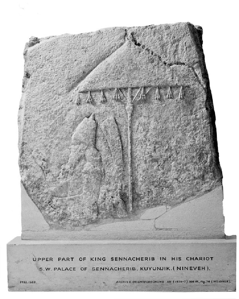 Relief fragment showing upper part of King Sennacherib in his chariot (AN1933.1669)