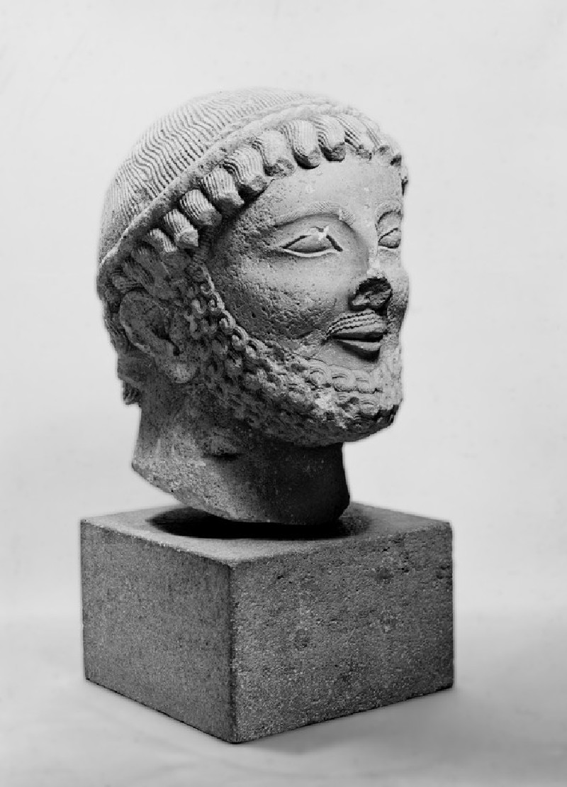 Bearded head of a male votary sculpture (AN1938.347)