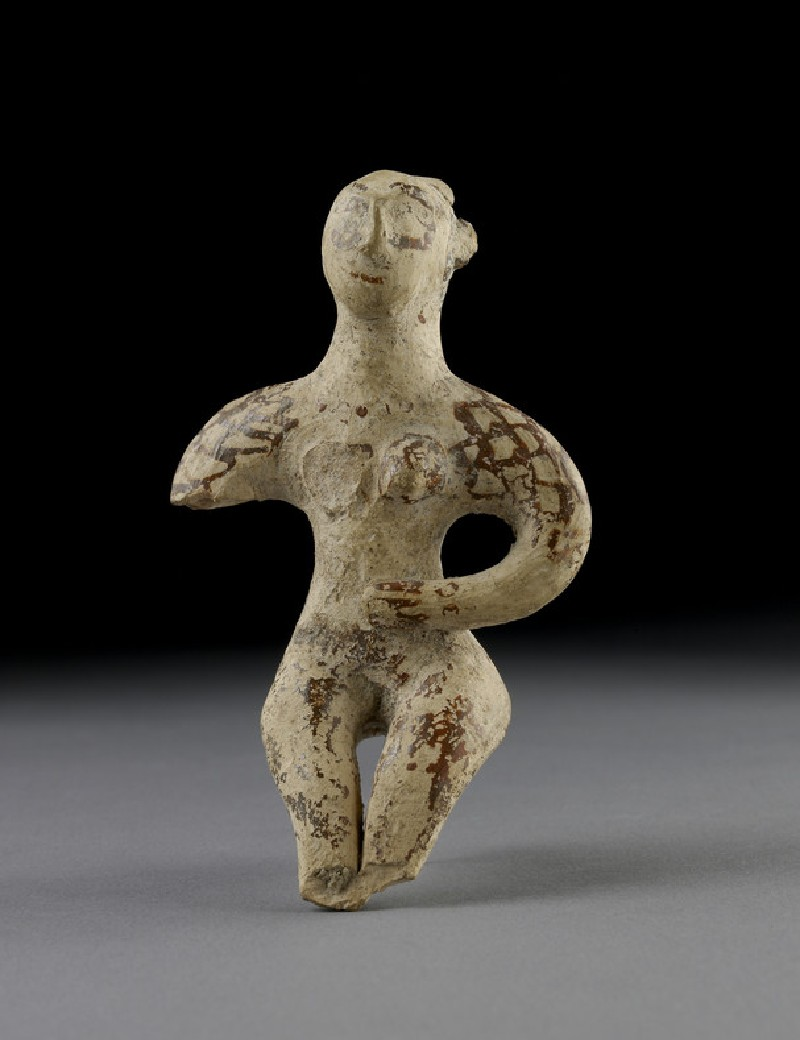 Terracotta figurine of a seated male (AN1938.502)